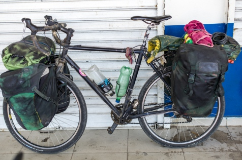Andy's Bike - a huge Load with a Machete on the Rack